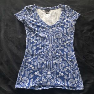 blue, tighter fitting shirt with floral design